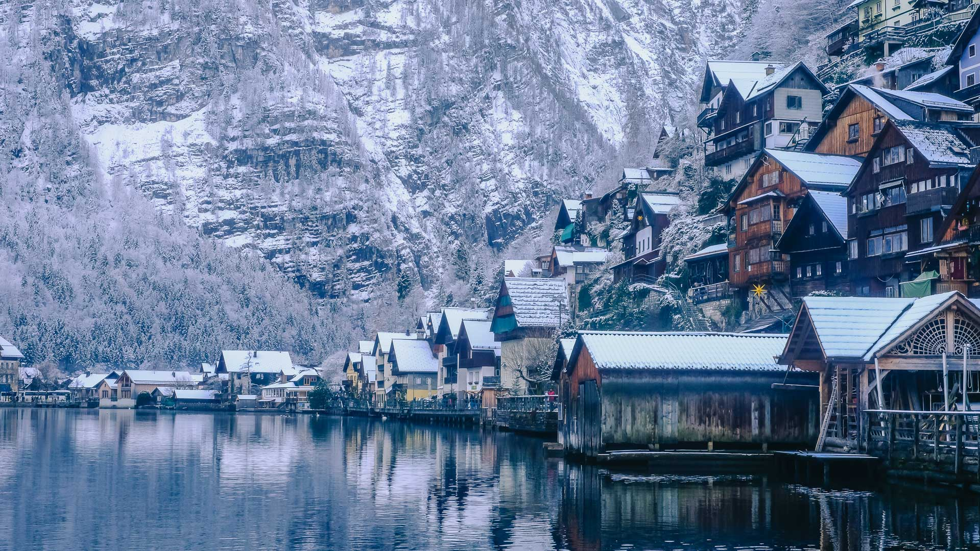 The Houses on the side of the Lake in Hallstatt with snow on the roofs