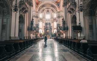 Man walking into the Salzburg Cathedral