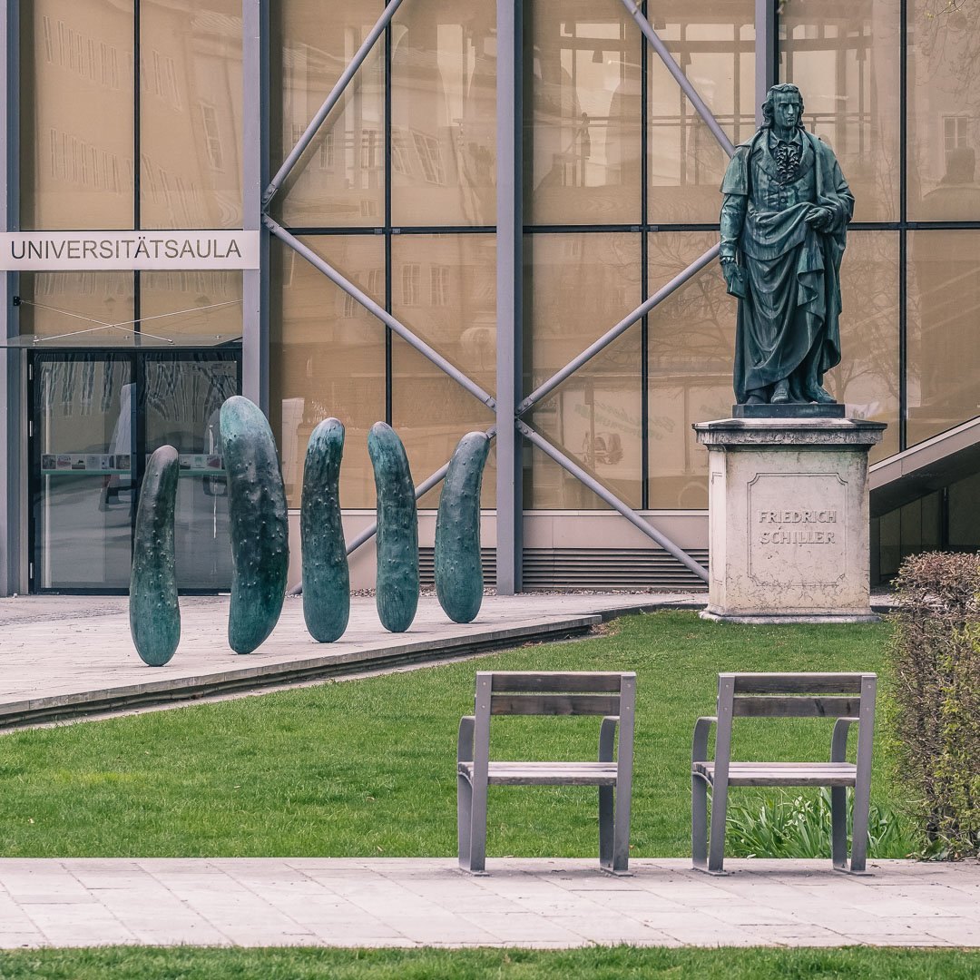 Pickles by Erwin wurm next to the Schiller statue in Furtwängler park