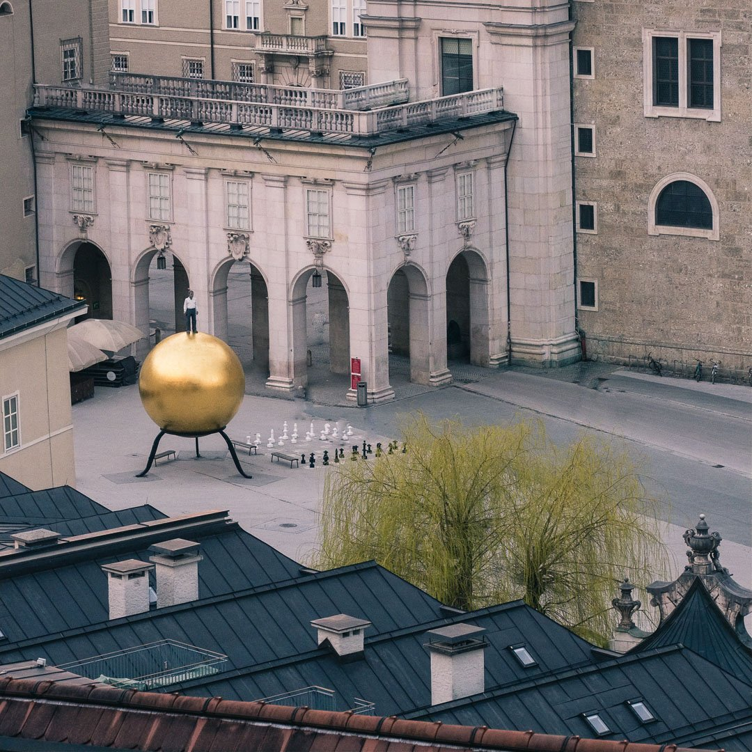 Kapitelplatz with the golden ball modern art piece by stefan balkenhol