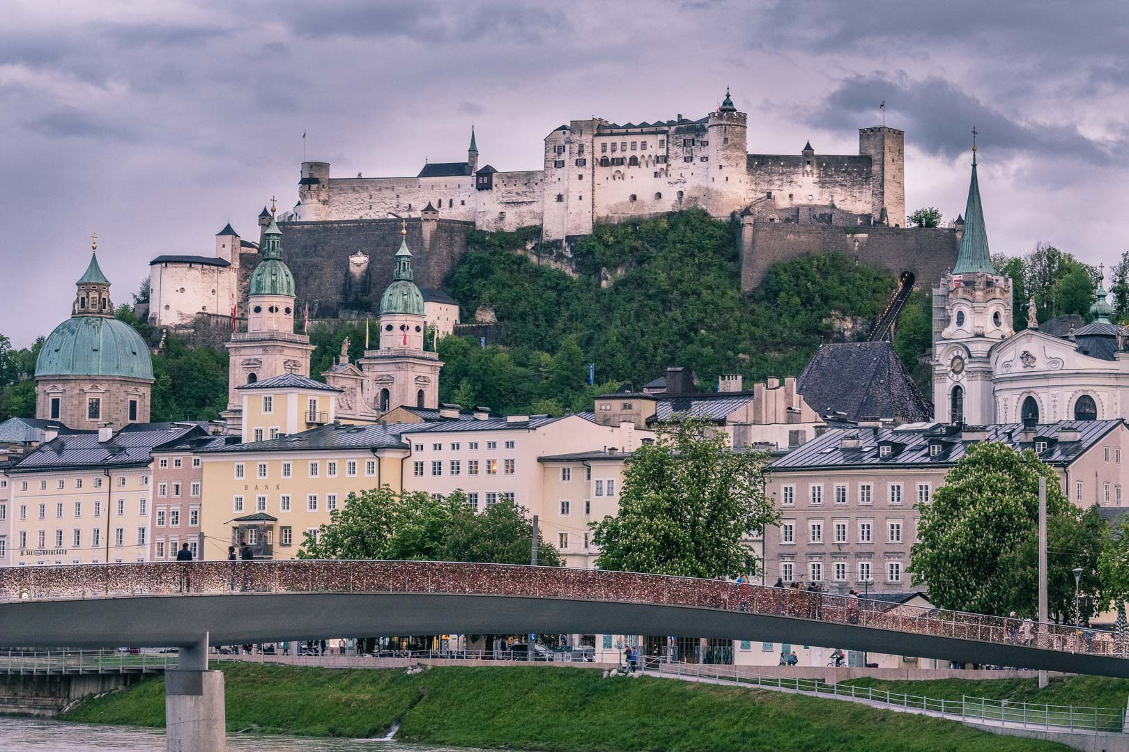 The Love Lock bridge in Front of the Hohensalzburg Fortress and the Salzburg old town