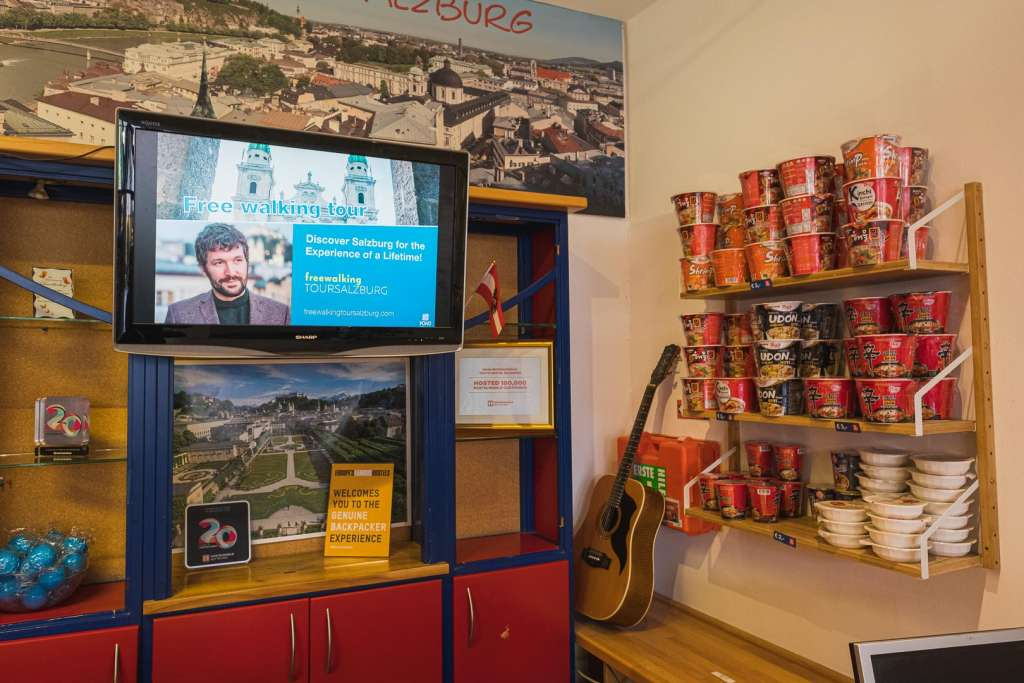 Advertising for the free walking tour salzburg at the reception of the yoho
