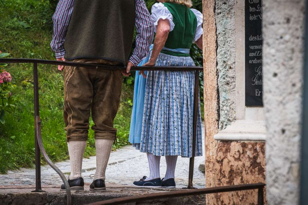 Austrian Couple in Lederhosn and Dirndl, traditional Austrian costumes.