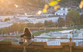 Girl enjoying the sunset from Capuchin Mountain in Salzburg