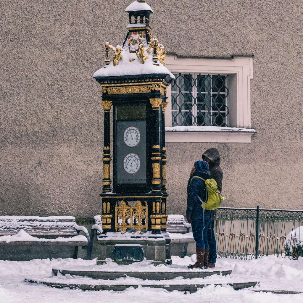 Backpackers at the Ceconi Weather Station at Alter Markt in Salzburg